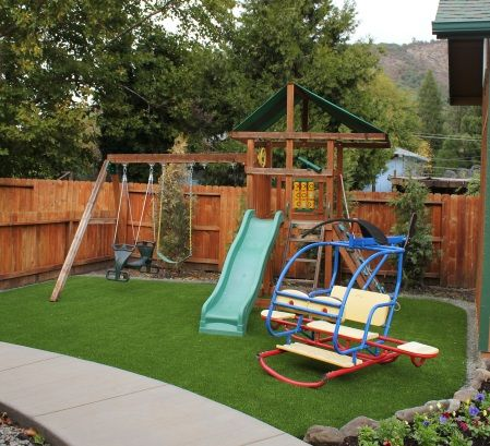 Artificial grass play areas with slide